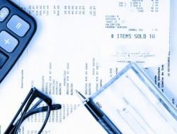 Bills, Calculator, Glasses, and checkbook
