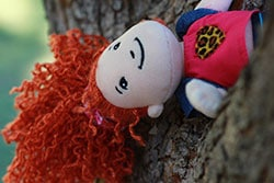sad-doll-in-a-tree