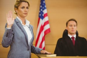 Witness in divorce trial swearing their oath