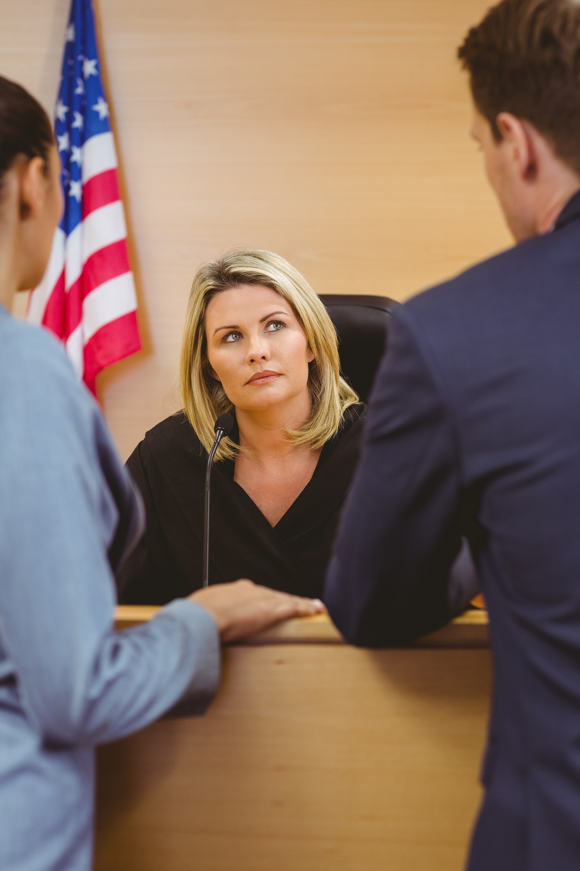 Lawyers conferring with a judge in family court